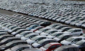 Peugeot cars are parked awaiting shipment to Italian dealers at the port of Civitavecchia