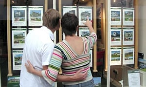 First-time buyers looking at estate agent's window