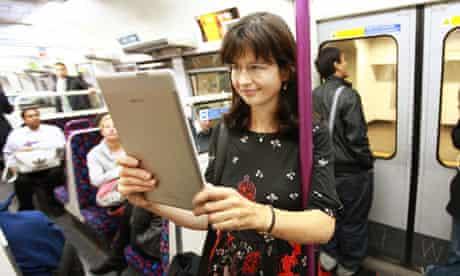 woman on Tube reading Kindle