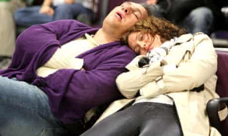 Passengers sleeping in airport