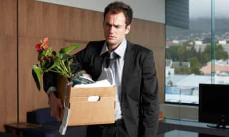 Depressed fired businessman carrying his belongings