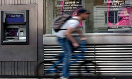 Man rides bike past NatWest brank