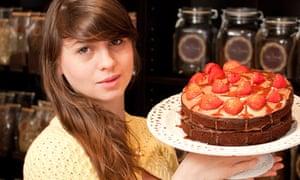 Carli-Jayne McNaught holding a cake