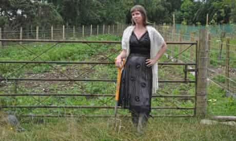 Kim Stoddart in field in black dress