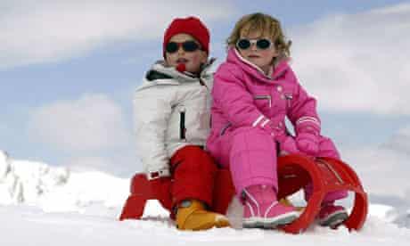 two children on toboggan