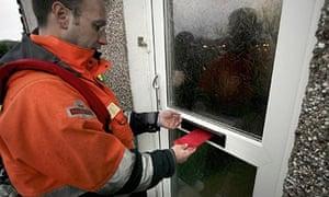 postman putting letter through door