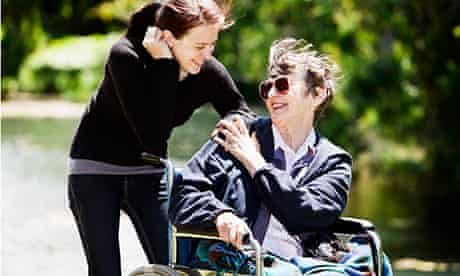 woman in wheelchair with younger carer