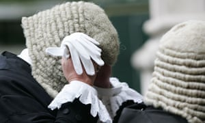 judge adjust his wig