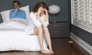 Feuding couple in bedroom