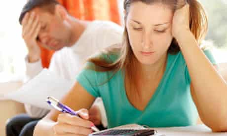 Worried couple with calculator