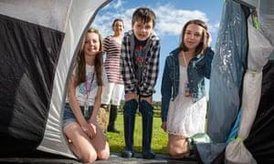 children looking into tent