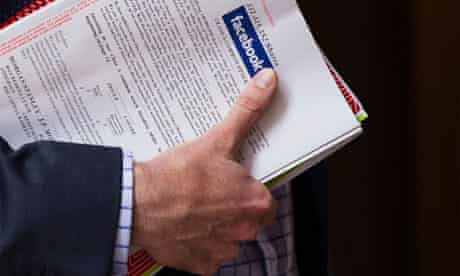 A man holds a Facebook pamphlet