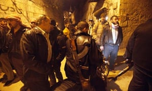 Syrian rebels gather in an alley
