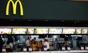 Staff gather in a McDonald's