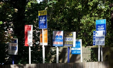 A row of for sale, to let and auction property signs in Birmingham, England