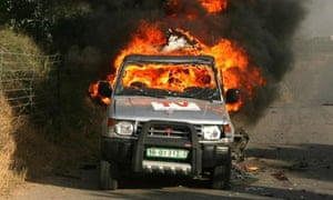 Car of Reuters cameraman Fadel Shana burning in Gaza
