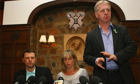 Clarence Mitchell with Kate and Gerry McCann. Photograph: Matthew Lewis/Getty Images