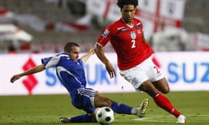 ngland's Glen Johnson challenges Andorra's Marc Pujol for the ball in a World Cup 2010 qualifying match