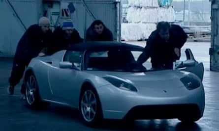 Jeremy Clarkson and the Top Gear team push the Tesla in to recharge its battery. Photograph: BBC