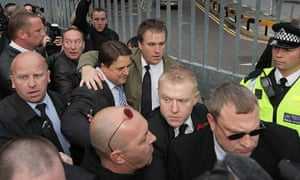 Question Time protests: Nick Griffin arrives at BBC Television Centre surrounded by bodyguards