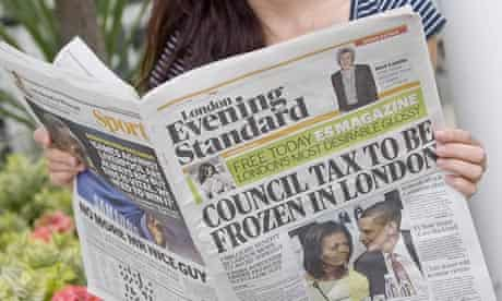 A woman reads the Evening Standard on the day it was announced it would go free