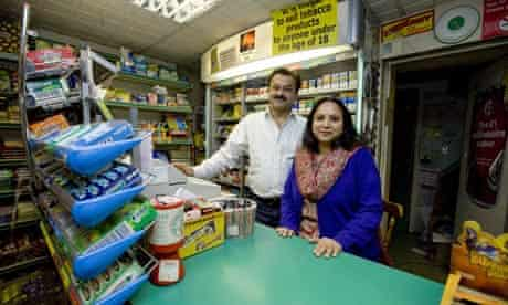 Daxa Solanki and her husband Amraish in their newsagent's shop which was visited by Rupert Murdoch