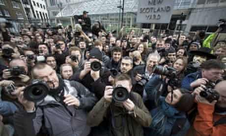 Photographers protest at a new anti-terror law