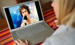 Woman watches Susan Boyle on Youtube on a laptop