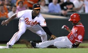 Baltimore Orioles third baseman Melvin Mora tags out Los Angeles Angels' Chone Figgins