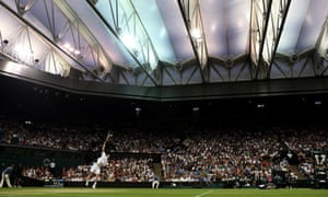 Wimbledon: Andy Murray serves under roof