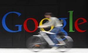 An employee rides her bike past Google's Zurich office