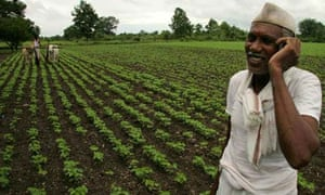A farmer ploughs his fields, India