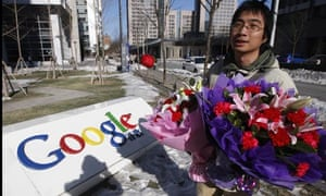A Chinese Google user with a bouquet of flowers at the Google China headquarters in Beijing