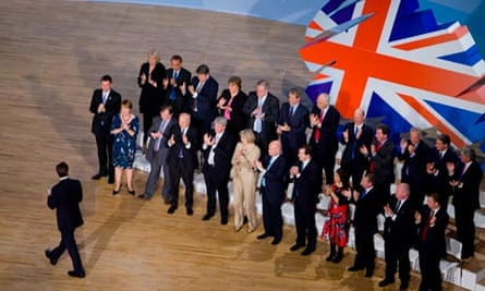 David Cameron is applauded by cabinet members at the Conservative party conference