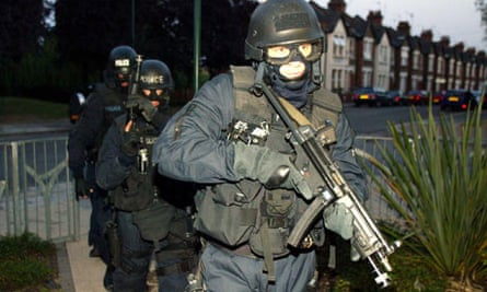 Operation Trident officers raid a flat in London in 2003