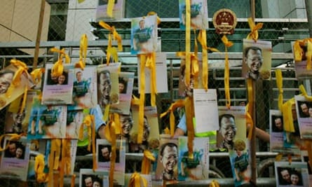 Pictures of Liu Xiaobo outside the Chinese liaison office in Hong Kong