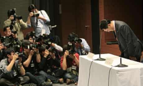 Toyota Motor Corp President Akio Toyoda bows at the start of a news conference in Nagoya