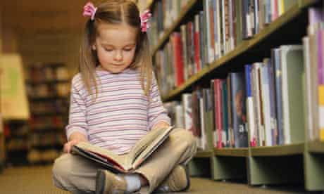 Young girl reading in library