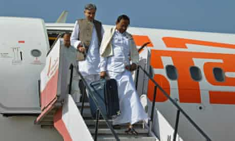 Indian home minister Palaniappan Chidambaram, front, arrives at Srinagar airport in Kashmir