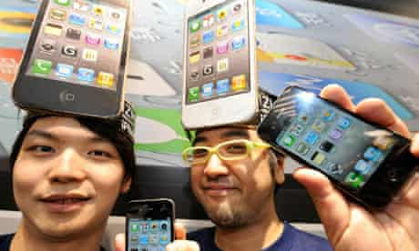 Wearing iPhone placards on their heads,