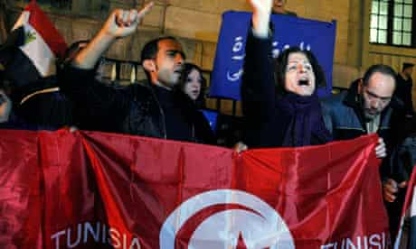 Egyptian activists with a Tunisian flag as part of anti-government demonstrations