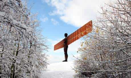 The Angel of the North statue in a snowy landscape