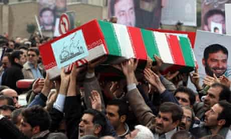 Iranians attend the funeral of revolutionary guards killed in an explosion near Tehran
