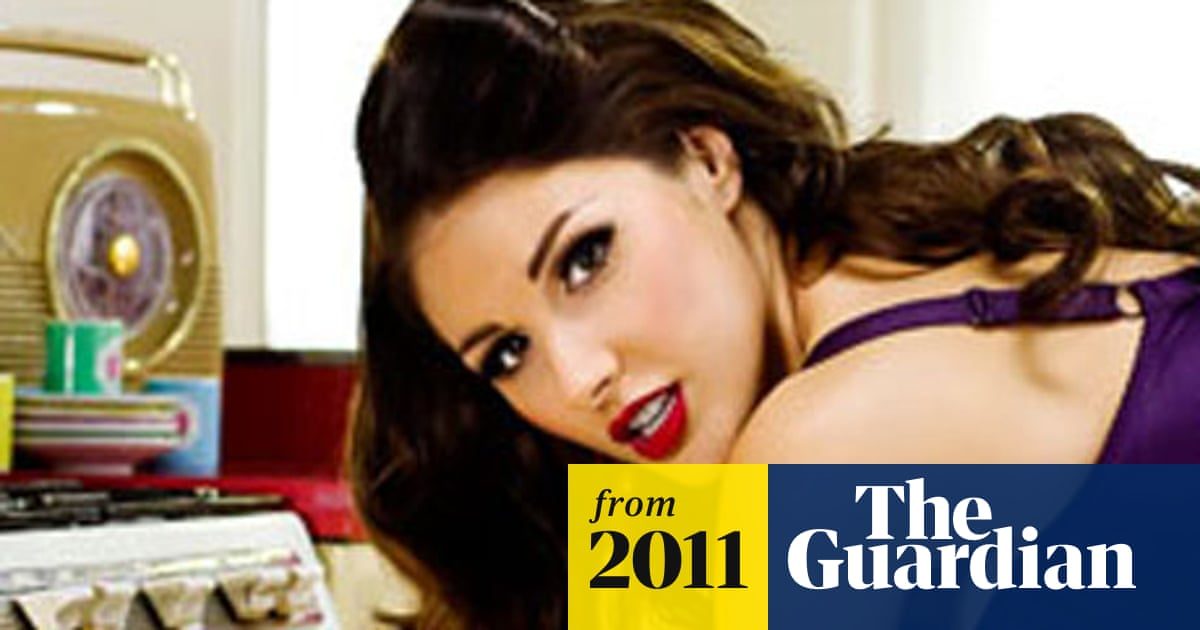 Lynx's Lucy Pinder ads banned by ASA | Media | The Guardian
