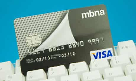 MBNA Credit card on a computer keyboard with a blue background