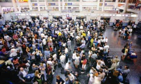 Passengers queue to check in at Gatwick airport