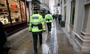 Police officers walk their beat in the City of London