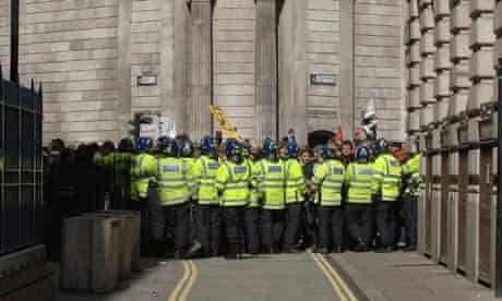 Riot police contain G20 protesters outside the Bank of England