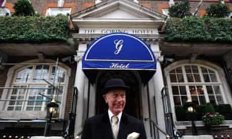 A doorman outside the Goring Hotel