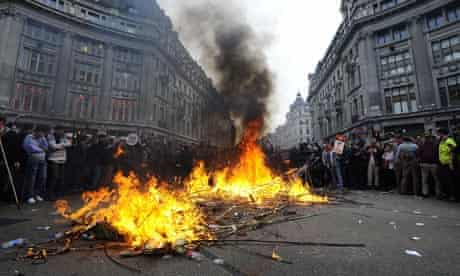 Cuts protest: activists start fires at London's Oxford Circus
